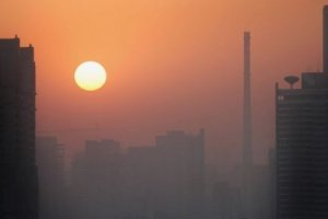 Sunrise over Beijing's polluted skyline.